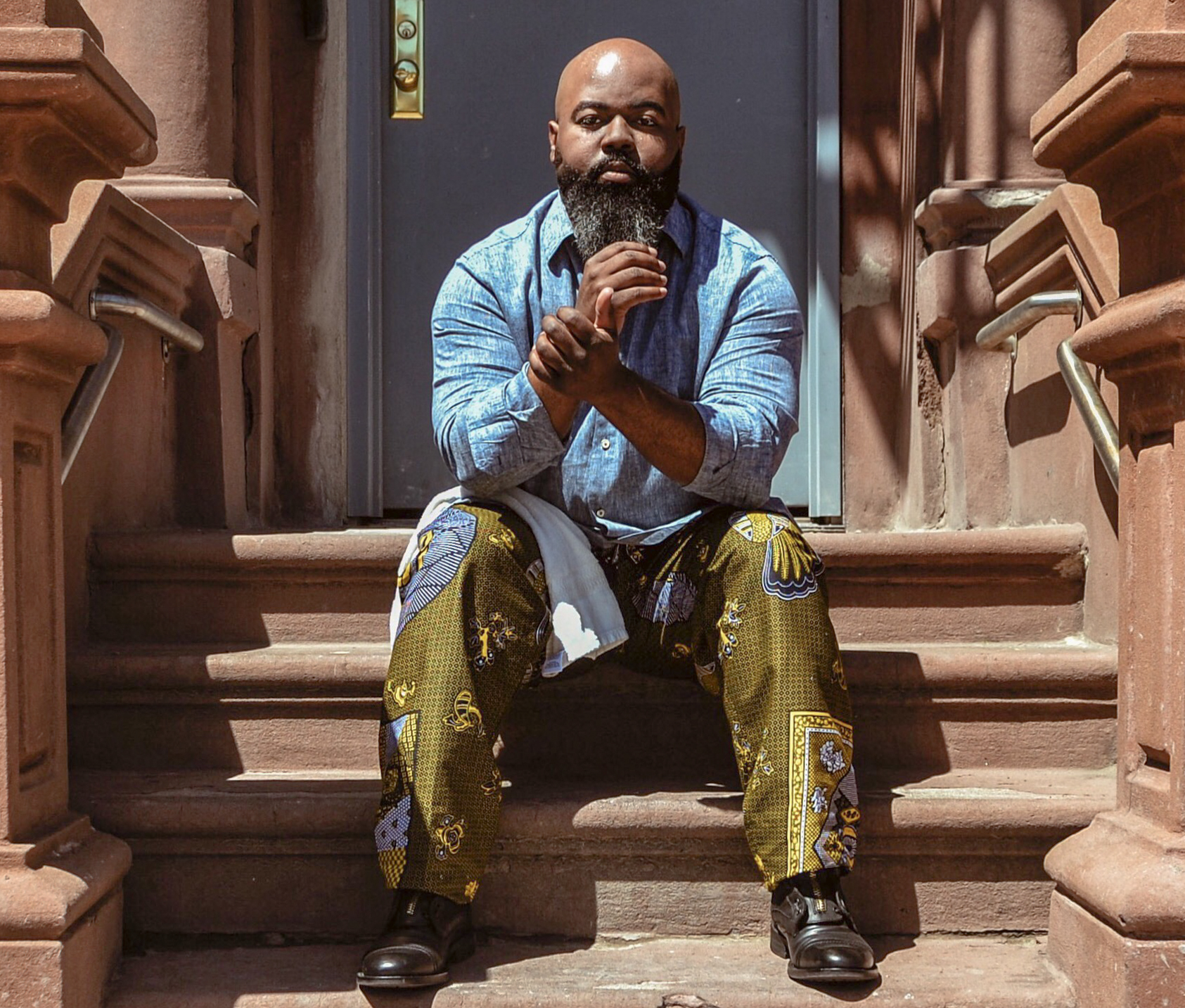 Environmental portrait of Harlem, NYC singer & vocal coach C. Anthony Bryant in front of his home.